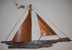 Wall hanging ship with copper sail and driftwood body. www.rlbrethauer.com