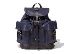 Backpack with exterior and internal compartments in soft calfskin.
