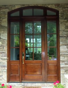 Another front door with sun damage to the lower half, after being restored by Roger.