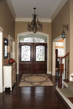 Entry with beautiful doors and chandelier.  #entryways #foyers homechanneltv.com