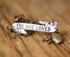 You Are Loved Bridesmaid Gift Flower Girl Gift Bridal Jewelry Shrink Plastic Bracelet. $32,00, via Etsy.