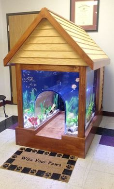 Custom 2-in-1 fish tank / dog kennel - incredible! #product_design  Wonder if the fish would scare Jack