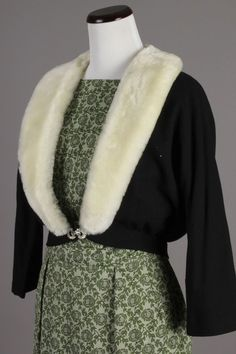 Small 50s-60s Vintage Black Wool Cardigan Sweater w/ White Faux Fur Collar. A beautiful vintage sweater that evokes old Hollywood glamour! Would go perfectly with an elegant cocktail dress for Holiday parties. $70 via eBay