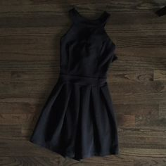 Black summer dress Halter top, all black dress! Super comfortable, only worn twice!! Perfect dress to wear to church, a wedding, on a date, or really anywhere! Plus.. what clothing item from Francesca's isn't amazing?? Francesca's Collections Dresses