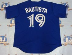 JOSE BAUTISTA Toronto Blue Jays Autographed Retro Replica MLB Baseball Jersey . $379.05. This is an official licensed SIGNED Jose Bautista Toronto Blue Jays jersey. The jersey is brand new with all of the lettering and numbering professionally sewn on. The player has beautifully signed the number. To protect your investment, a Certificate Of Authenticity and tamper evident hologram from A.J. Sports World is included with your purchase. Nfl Saints, Sports Page, Toronto Blue Jays, Baseball Jerseys, Mlb, Soccer, Cute Outfits, Hologram, Retro