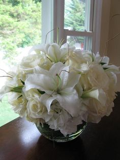 "Decor Galore - 8"" Glass Bubble; white hydrangea, white oriental lilies, white blizzard roses, white calla lilies, green lily grass and curly willow branches"