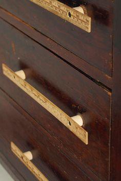 Vintage Rulers as drawer pulls.