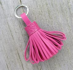 Very elegent and chic leather tassel / keyfob. This listing is for the tassel keyfob / keychain made of fuchsia pink soft lambskin. The top end is made of ostrich leg leather in the same beautiful color.    It has a silver tone metal keyring.    The keyfob is glued and handstitched with strong thread thread    Picture 5: the tassel keyfobs I recently made.    If you like gold metal or old gold tone/brass keyring, please put that convo when checking out      Dimension:  Total le...