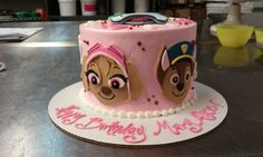 A six inch Paw Patrol cake with fondant 2D Skye and Chase faces.