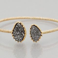 Faux grey Druzy cuff bracelet New! Bundle and save 15%. Gold tone 2.5 inch diameter cuff bracelet. This is not from my handmade Druzy style collection.  PRICE FIRM if not bundled Jewelry Bracelets