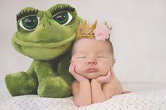 newborn baby girl with princess tiara and her frog