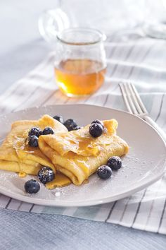 Make any day extra special with these delicious Honeyed Blueberry Breakfast Blintzes. With sweet vanilla, citrusy orange, warm cinnamon and golden honey, there is no better way to start off your morning! This treat will be a family favorite and an absolute must this Mother's Day.