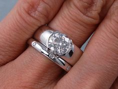 1.66 ctw Round Cut Diamond Engagement Ring and Matching Wedding Band Set. It has an alluring 1.55 ct G color/SI2 clarity, Clarity Enhanced (Fracture Filled) Round Cut Center Diamond. Set in a gorgeous 14K white gold setting, this set is listed for $5,590! Follow this link to view this listing on our website: http://www.bigdiamondsusa.com/1ctwrocutdiw1.html Email: diamonds@bigdiamondsusa.com Website: www.BigDiamondsUSA.com