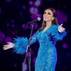 Angham in light blue dress