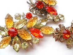 BEAU JEWELS Brooch-Earring Set, Carved Glass, Orange Yellow Floral, Vintage by RenaissanceFair on Etsy https://www.etsy.com/listing/261755809/beau-jewels-brooch-earring-set-carved