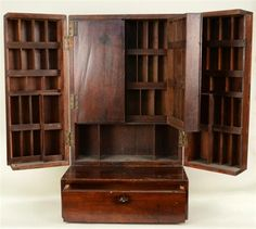 MAHOGANY APOTHECARY CABINET, 19th century; height: 30 inches
