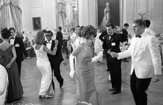 Daughters and sons of Washington diplomats swing in the staid East Room of the White House in Washington, on June 18, 1965. They were guests of Luci Johnson, the 17-year-old daughter of the president; Charles Tasnadi