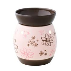 Doodlebud Full-Size Scentsy Warmer    Sweet embossed flowers of brown and pink float against a dreamy, pink background. The base bottom and lid balance things out with a matching brown, all in a high-gloss finish.