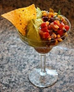 Serving salsa and guacamole in a margarita glass. Love this for a Mexican themed party!!
