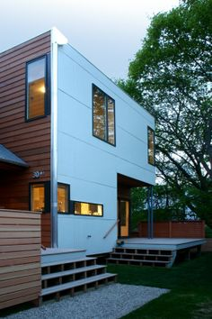Exterior siding using Hardie Board smooth panels Interesting angle approach but may be too modern even more me?