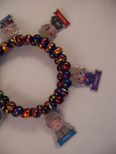 Hetalia!!  Hetalia anime charm bracelet with France, England, China, Canada, Russia and America.  All Hetalia anime jewelry can be ordered with your choice of countries, and uses only legal licensed charms.