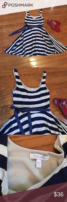 Delia's Nautical navy striped Fit&Flare w/belt Delia's Nautical navy striped fit&flare dress size small with ribbon belt. EUC no flaws. Super cute. Runs a bit smaller, fit better an extra small. Offers welcome. Delia's Dresses
