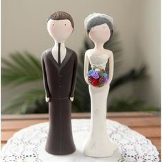 Traditional wedding cake toppers aren't a must. I love this fun variation for a cake.