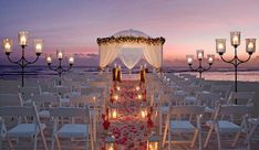 Thinking of planning a destination wedding? Our destination wedding guide has everything you need to plan your big day. Find the perfect wedding location and venue, and find expert destination wedding planning advice before you walk down the aisle. Night Beach Weddings, Beach Wedding Aisles, Beach Wedding Makeup, Wedding Aisle Decorations, Sunset Wedding, Beach Ceremony, Beach Night, Jamaica Wedding, Jamaica Beach