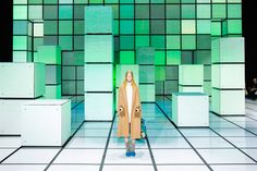 Colourful illuminated surfaces based on 8-bit graphics and Rubik's cubes formed the backdrop for designer Anya Hindmarch's London Fashion Week catwalk show.