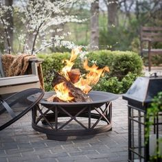 """This unique fire pit features a 30"""" black steel fire bowl which sits atop a decorative powder coated steel base. This fire pit comes complete with a one piece dome spark screen with high heat paint an"""