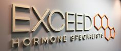 Exceed Hormone Specialists sign. Logo by Kitbash Brand Design.