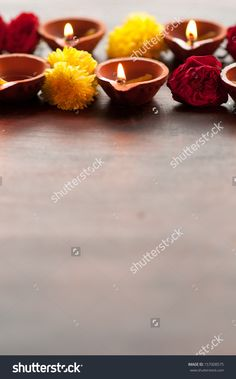 stock-photo-diwali-diyas-in-a-row-on-a-isolated-white-background-with-flowers-or-floral-decorations-157008575.jpg (996×1600)