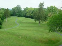 Serpent Mound (by Ann Merrill) - Serpent Mound, Ohio. It was first positively dated and attributed to the Native American Adena culture (c. 800 BCE - 1 CE) but later excavations strongly suggested it was built by the natives of the so-called Fort Ancient culture (c. 1000-1750 CE) and, most likely, around 1070 CE.