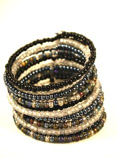 Hey, I found this really awesome Etsy listing at https://www.etsy.com/listing/180544399/beaded-cuff-bracelet-neutral-seed-beads