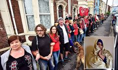 Moment neighbours form a human chain around a mother's house