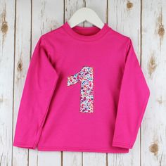 Girls Birthday Shirt | 1st Birthday Outfit | Personalised Number t-shirt | Liberty Print Pheobe Monogram Childs Shirt | Long Sleeve t-shirt by BettyBramble on Etsy https://www.etsy.com/uk/listing/498332966/girls-birthday-shirt-1st-birthday-outfit