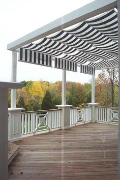 OMG love this awning! Shadetree Canopy retractable awnings installed over a mahogany deck in Butler Township just north of Dayton Ohio - Awnings Photo Gallery - Archadeck of West Central Southwest Ohio