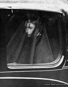 The veiled now Queen Elizabeth is driven in a closed car behind the coffin of her late father in the procession from Sandringham Church to Wolferton Station, Norfolk, this morning, 11th February 1952.  In the same car were the Queen Mother and Princess Margaret.