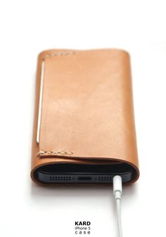 An iPhone case and premium leather wallet in one / Koncept