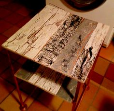Bedside table made of copper rods and planks i painted with wood glue and paint