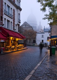 Have breakfast on a misty morning at a cafe near Sacré Cœur, Paris, France