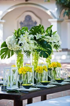 Tall Tropical Cylinders reception wedding flowers, wedding decor, wedding flower centerpiece, wedding flower arrangement, add pic source on comment and we will update it. www.myfloweraffair.com can create this beautiful wedding flower look.