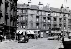 Springburn Road - my mother was a cashier at the Co-op when she was fifteen! Glasgow Scotland, Scotland Travel, Glasgow City, Destruction, British, Street View, Memories, Shops, Image