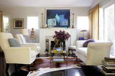 For small areas, designer Claudia Benvenuto uses furniture that doesn't seem to take up a lot of room, like the glass cocktail table in her living area. Mirrors, as well as glass, acrylic, metal, and gilt pieces help animate petite spaces. Tour the home that inspired this solution Joe Schmelzer  - ELLEDecor.com
