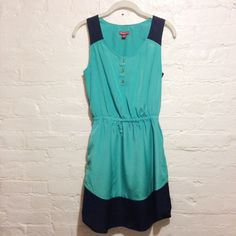 Navy and Turquoise Tank Dress Excellent condition tank dress. Elastic waist. Missing the waist tie but the little strings are still present--keep 'em or cut 'em, it's up to you! Cute alone or with a cardigan, tights and boots. Merona Dresses
