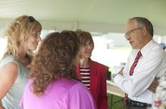 President Eisler enjoys a word (or two) with people during Founders' Day at Ferris.
