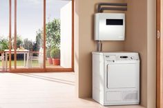 Miele introduces an ingenious clothes dryer that uses solar power and, ironically, water to dry clothes. Will it be coming to the USA soon?