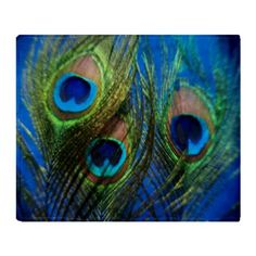 CafePress Blue Peacock Feather Throw Blanket - Standard Multi-color CafePress http://www.amazon.com/dp/B00MV8W0ES/ref=cm_sw_r_pi_dp_YDIsub1TM8KM6