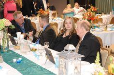 Tables each had a teal runner, hydrangeas, lamps & a framed menu