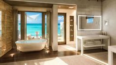 The Sandals Royal Caribbean resort...Other fringe benefits include a Jacuzzi, outdoor showers and a king sized bed with Egyptian linens and plush pillows.